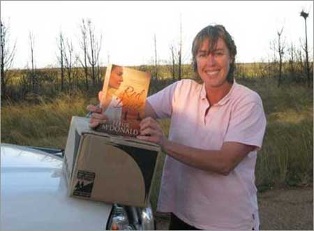 Holding my first book Red Dust For the first time