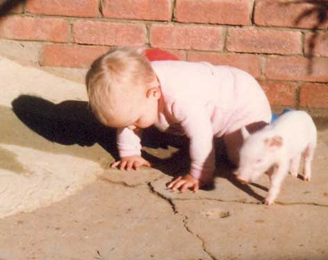 The young Elizabeth Brennan and her pet pig