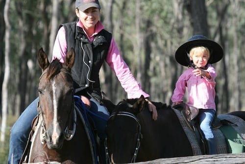 Tess and Adelaide McArthur enjoying a ride on their property