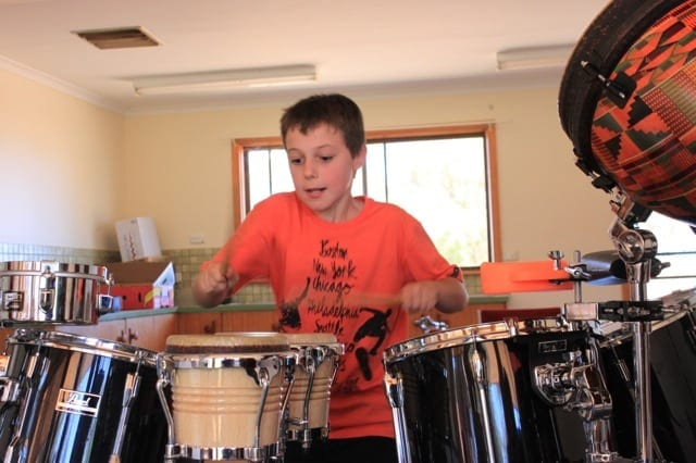 Hayden playing the drums